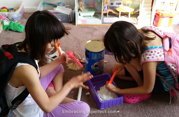 2 girls play sands alive