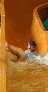 Zoe on water slide