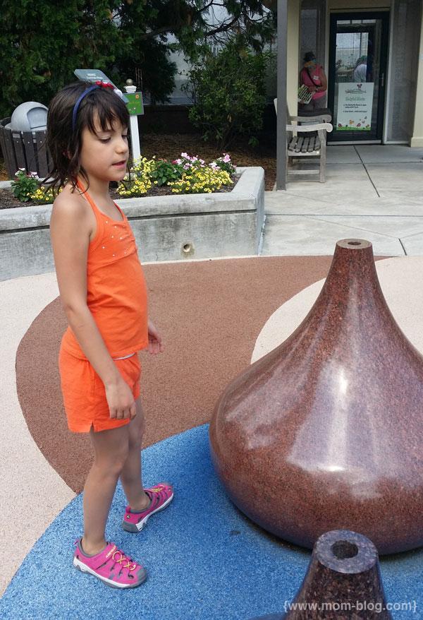 girl and giant hershey kiss