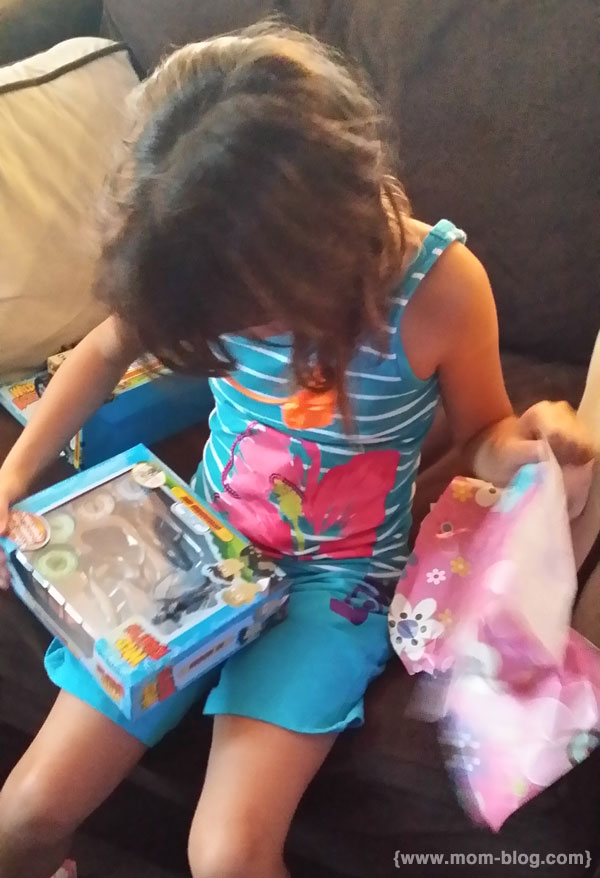 Girl opens present