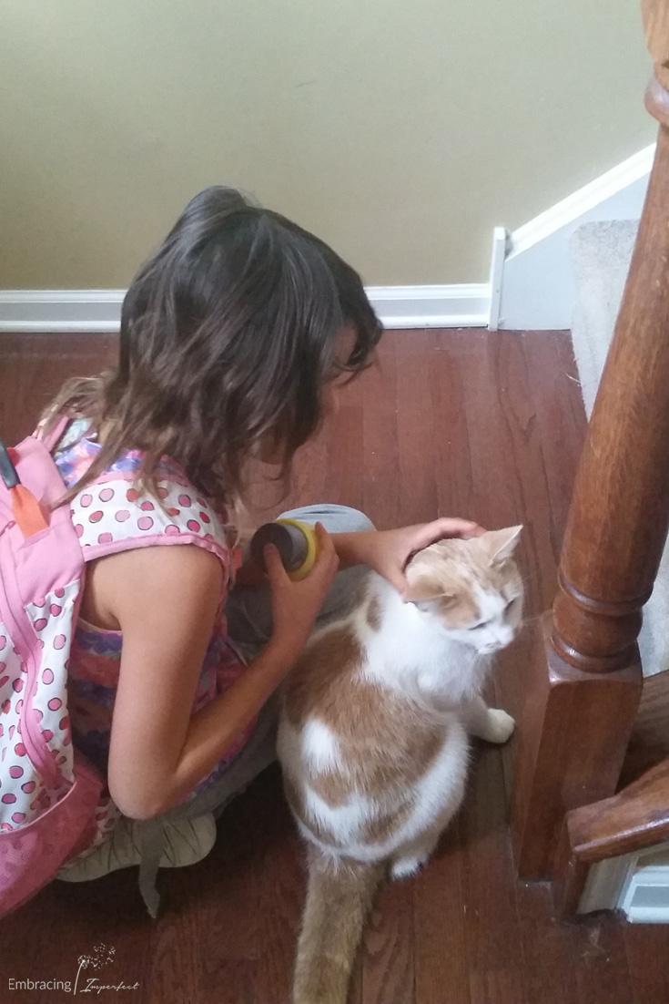 girl with autism and cat